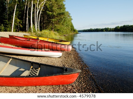 Canoes and Kayaks - stock photo