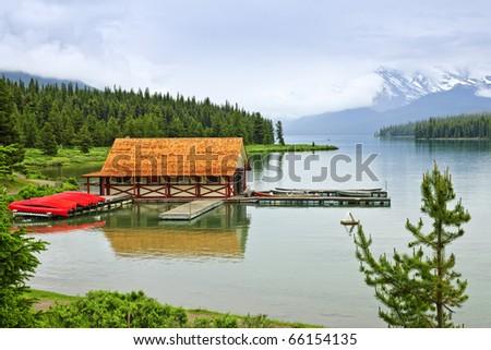 Canoes at boathouse on Maligne Lake in Jasper National Park, Canada - stock photo