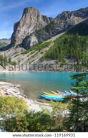 Canoes at the Moraine Lake at the Banff National Park in Canada - stock photo