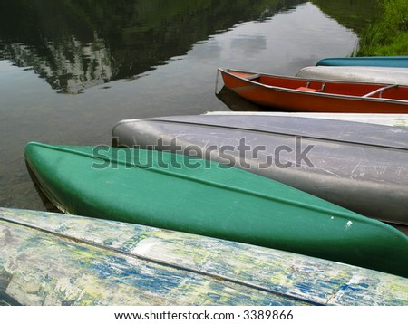 Canoes docked at a mountain lake in Colorado - stock photo