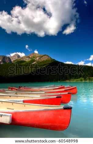 canoes on beautiful tourquoise lake - stock photo