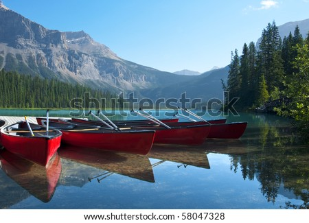 Canoes on Emerald Lake waiting to be rented. - stock photo