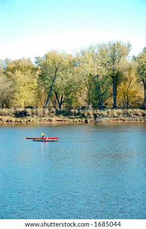 Canoes on Mississippi river. - stock photo