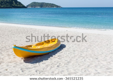 Canoes on the sand beach - stock photo