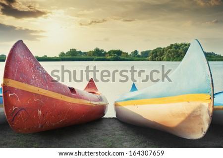 Canoes on the shore at lake Tisza, Hungary. - stock photo
