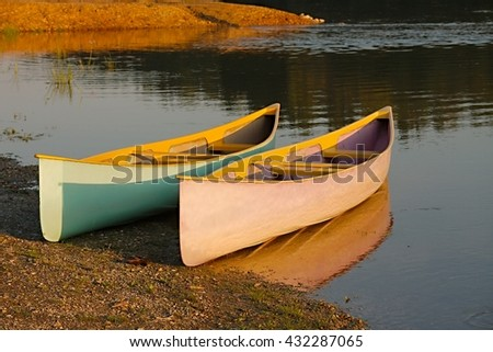 Canoes parked on the riverside - stock photo