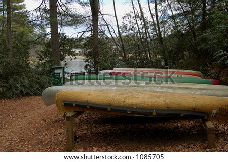 Canoes waiting for summer - stock photo
