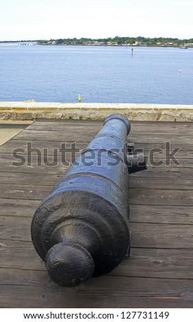 Canon from the 16th century aiming at the bay and sea, Castillo de San Marcos, Florida - stock photo