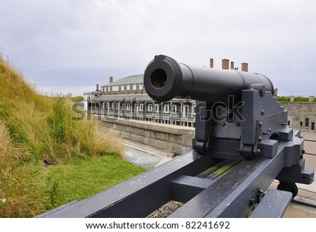 canon on the Citadel Hill with the historic building in the background, Halifax, Nova Scotia Canada - stock photo
