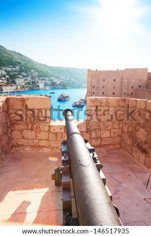 Canon on walls of Dubrovnik, Croatia pointed to the city port - stock photo