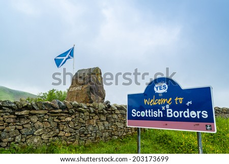 CANONBIE, SCOTLAND - June 14,2014: Passing the Scottish Borders on June 14, 2014 near Canonbie, Scotland, Great Britain. The signpost has a sticker with the word YES attached. - stock photo