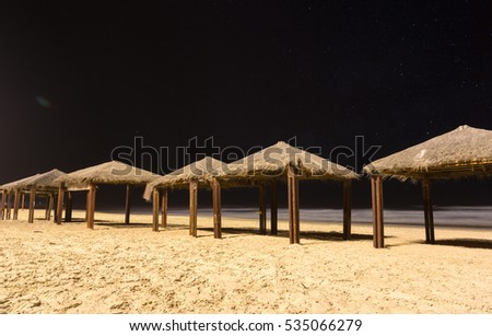 canopies from sun on the beach at night