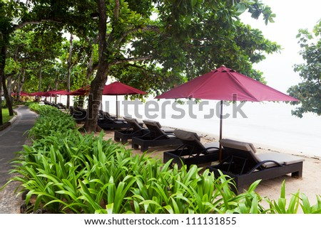 Canopies from the sun on a beach in Bali - stock photo