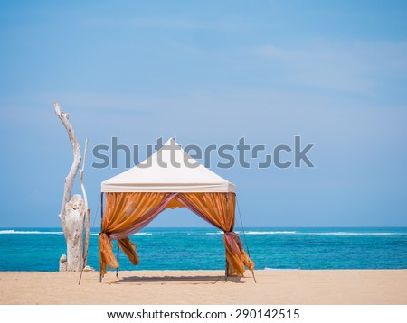 canopy on Kuta beach in Bali Indonesia - stock photo