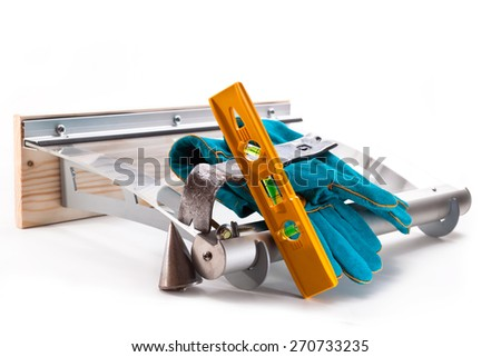 Canopy polycarbonate, mount, level, plumb and gloves on a white background - stock photo