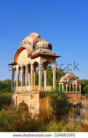 Canopy structures at historic Fatehsagar Water reservoir in Jhunjhunu Rajasthan India - stock photo