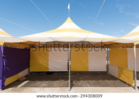 Canopy tent set up outdoors with flag on top is empty - stock photo
