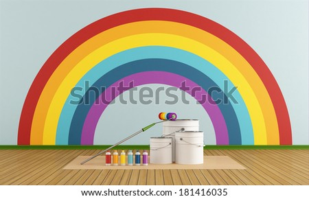 Cans and bottles colorful paint and roller brush in front at wall with rainbow - stock photo