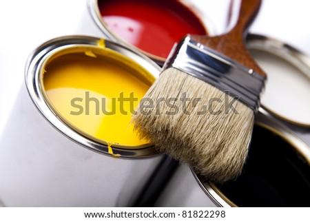 Cans of paint with paintbrush - stock photo