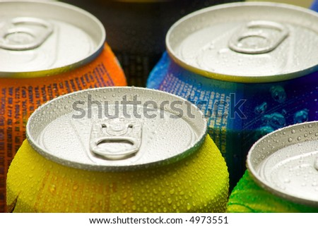 Cans of soft drink. Cooling frozen and with water drops