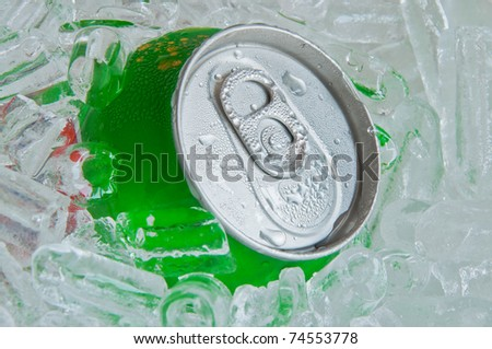Cans of soft drink, cooling frozen and with water drops in ice background - stock photo