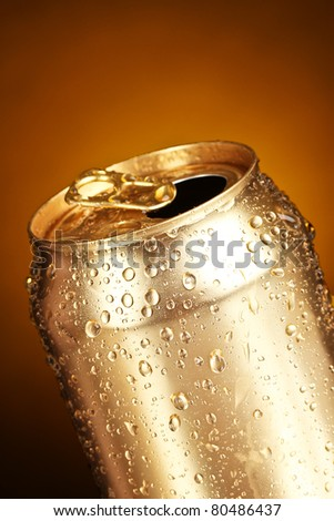 cans on a yellow background - stock photo