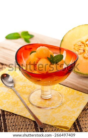 Cantaloupe Melon and Mint. Shallow dof. Selective soft focus. - stock photo