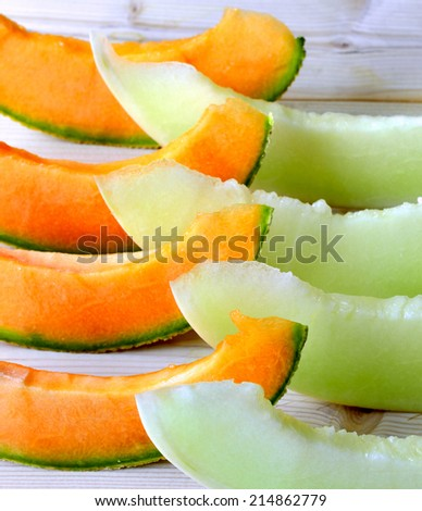 Cantaloupe melon slices of fresh juicy yellow red green. - stock photo