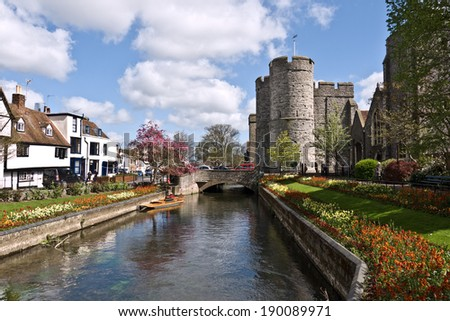 CANTERBURY,UK-APRIL 17: The  Westgate Towers and gardens. The towers are the largest surviving medieval gate in England. Canterbury has over six million visitors a year.April 17 2014, Canterbury UK - stock photo