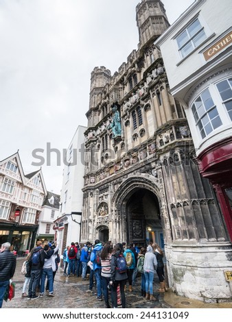 CANTERBURY, UK - JAN 13, 2015. Students gather outside Canterbury cathedral entrance. In 1170 Archbishop Thomas Becket was murdered in the Cathedral which now attracts thousands of tourists. - stock photo