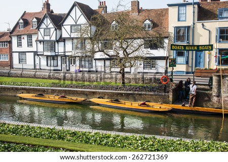 CANTERBURY, UK - MARCH 17, 2015: A tudor style house and punting boats available for hire along the river Stour and Westgate Gardens Riverwalk. This site has been a public space since the Middle Ages. - stock photo