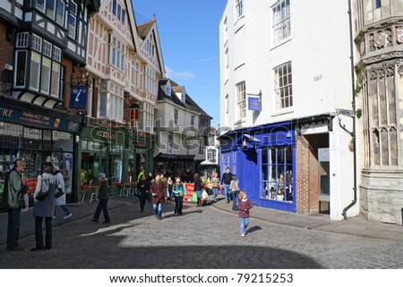 CANTERBURY,UK-May 31:Tourists besides the Cathedral May 31,2011 in Canterbury.Being the location of the Mother Church of the Anglican Communion,Canterbury attracts more than 1 million visitors a year - stock photo