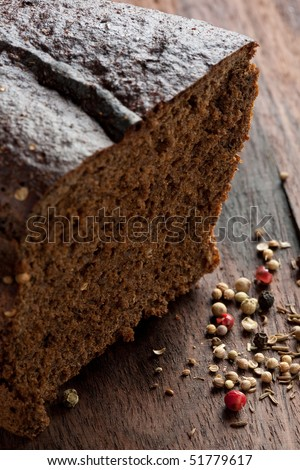 Cantle and slice of dark rye bread or cake - stock photo