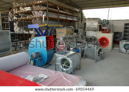 CANTON, CHINA - NOVEMBER 11: One of the biggest manufacturer of auto spray booths and generators in China. Warehouse with components for generators on November 11, 2010 in Canton, China. - stock photo