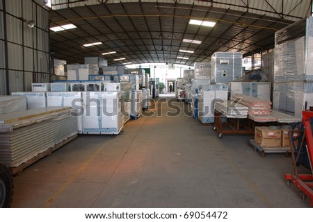 CANTON, CHINA - NOVEMBER 11: One of the biggest manufacturer of auto spray booths and generators in China. The biggest warehouse with generators on November 11, 2010 in Canton, China. - stock photo