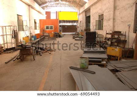 CANTON, CHINA - NOVEMBER 11: One of the biggest manufacturer of auto spray booths and generators in China. Warehouse with metal components on November 11, 2010 in Canton, China. - stock photo