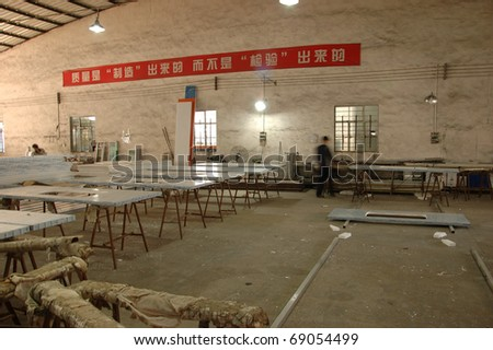 CANTON, CHINA - NOVEMBER 11: One of the biggest manufacturer of auto spray booths and generators in China. Wall panel warehouse on November 11, 2010 in Canton, China. - stock photo