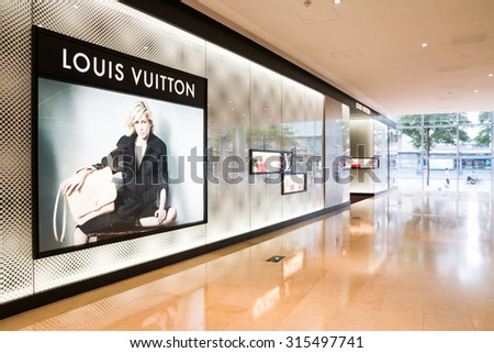 CANTON,CHINA - SEP 10: Louis Vuitton shop on Sep 10, 2015 in Canton. Forbes claims Louis Vuitton was the most powerful luxury brand in the world in 2008 with $19.4bn USD value. LV was founded in 1854 - stock photo