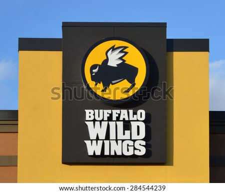 CANTON, MI - DECEMBER 30:  Buffalo Wild Wings, whose Canton location logo is shown on December 30, 2014, has over 800 restaurants.  - stock photo