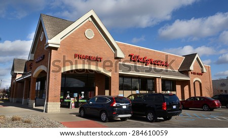 CANTON, MI - DECEMBER 31:  Walgreens, whose Canton location is shown on December 31, 2014, have over 8,000 locations.  - stock photo