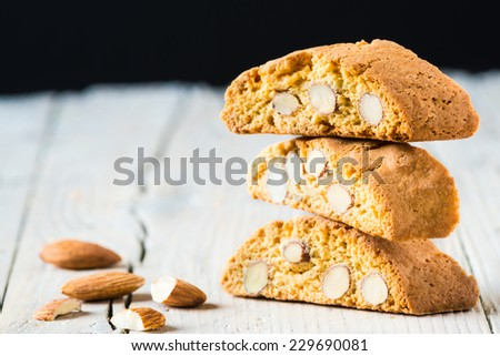 Cantuccini on white wooden background, typical tuscan biscuits. - stock photo