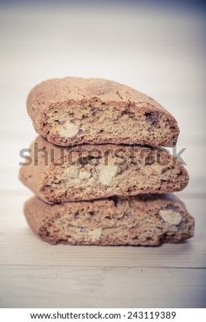 Cantuccini on wooden background, typical tuscan biscuits with almonds  - stock photo