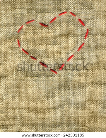 canvas background with an embroidered red heart