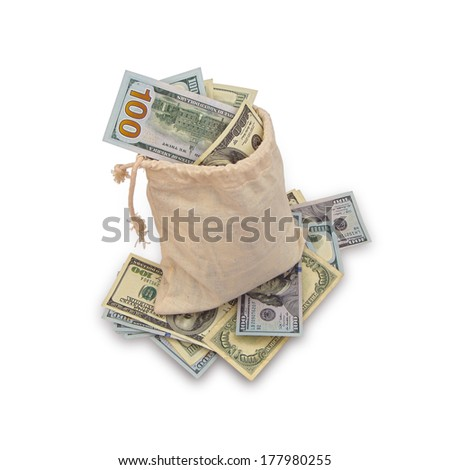 Canvas Bag Stuffed With Hundred Dollar Bills, Sitting On More Hundred Dollar Bills - stock photo