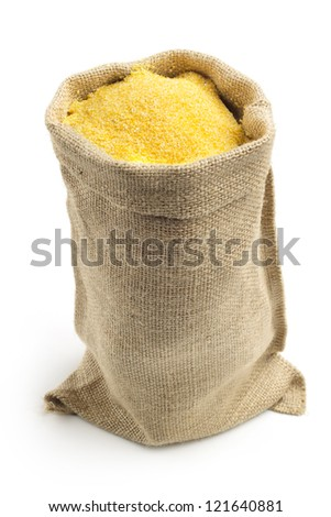 canvas bag with cornmeal isolated on white background - stock photo