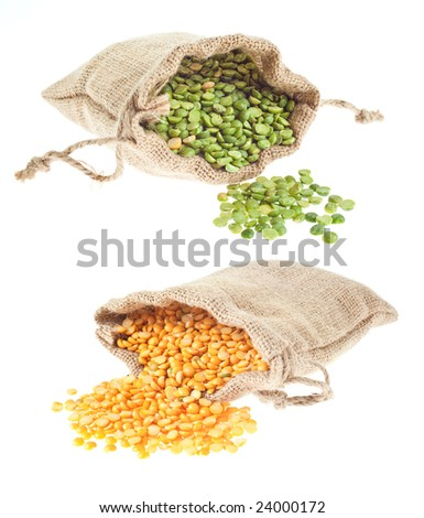 Canvas bags of dry yellow and green split peas spilling out - stock photo
