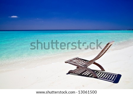 Canvas Chair on tropical beach - stock photo