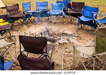 Canvas Chairs Around Camp Fire