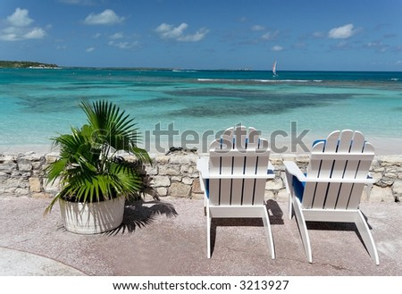 Canvas chairs on a beautiful caribbean terrace - stock photo