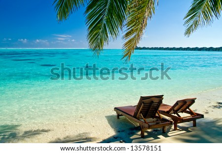 Canvas Chairs on tropical beach - stock photo